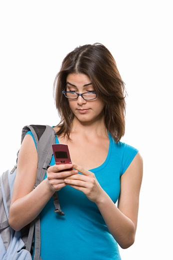University student text messaging on a mobile phone : Stock Photo