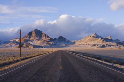 Road leading towards a mountain, Wendover Peak, Utah, USA : Stock Photo