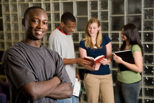 Stock Photo: 1574R-35471 Group of young adults study together in a library