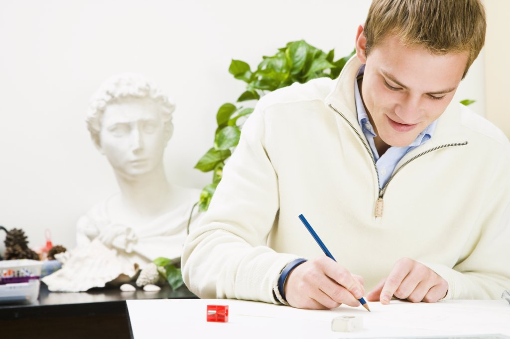 Stock Photo: 1574R-35959 Man drawing with a pencil on a sheet