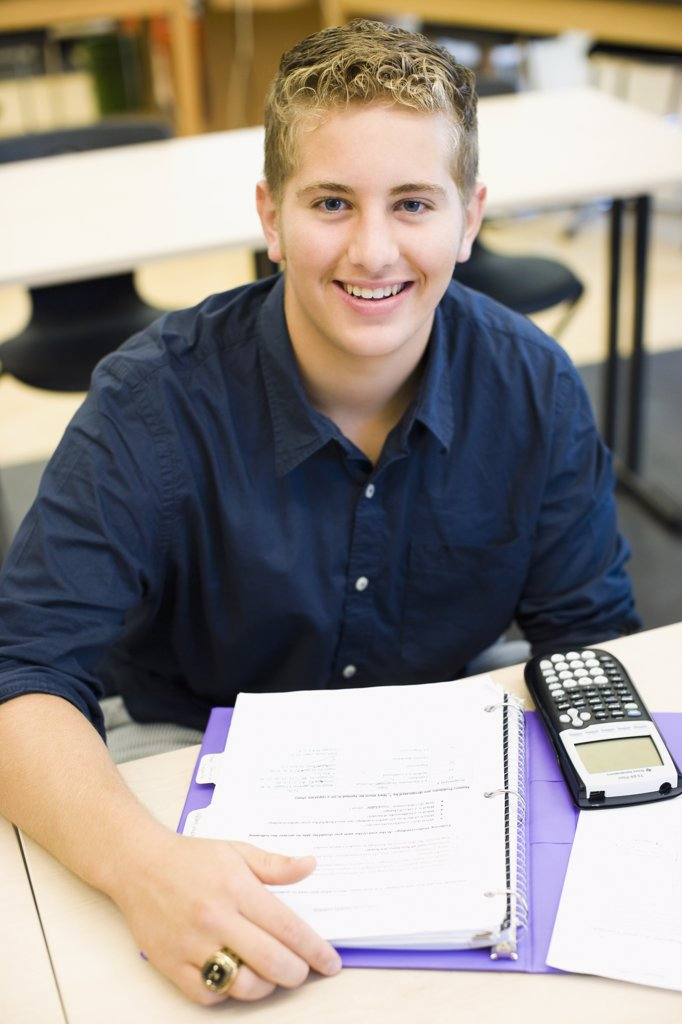 Student in a classroom : Stock Photo