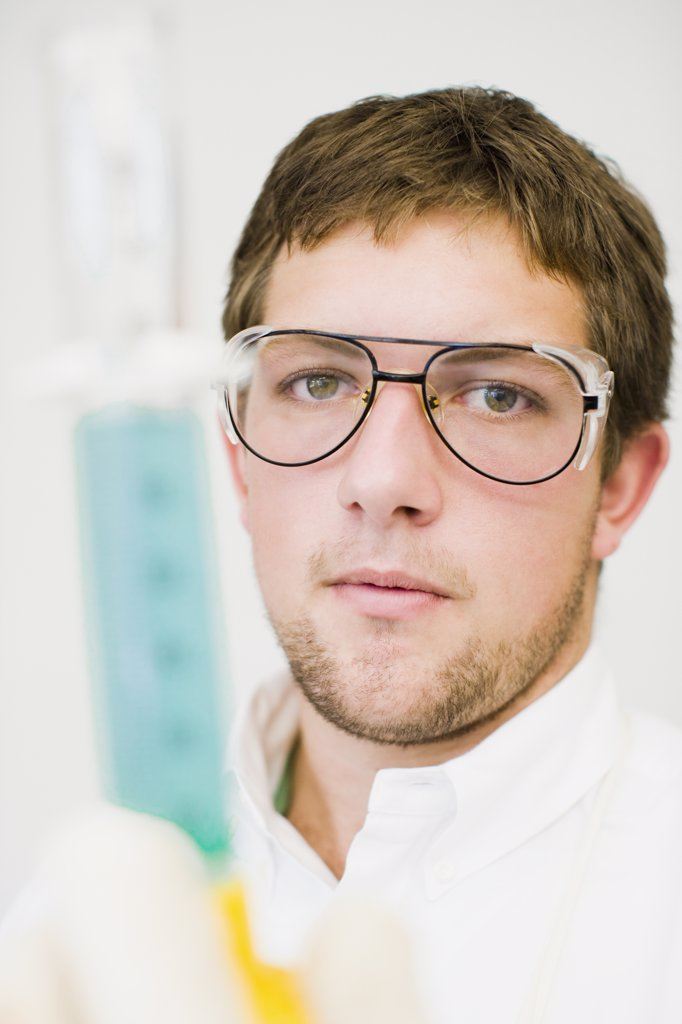 Stock Photo: 1574R-36255 Student doing a scientific experiment in a laboratory