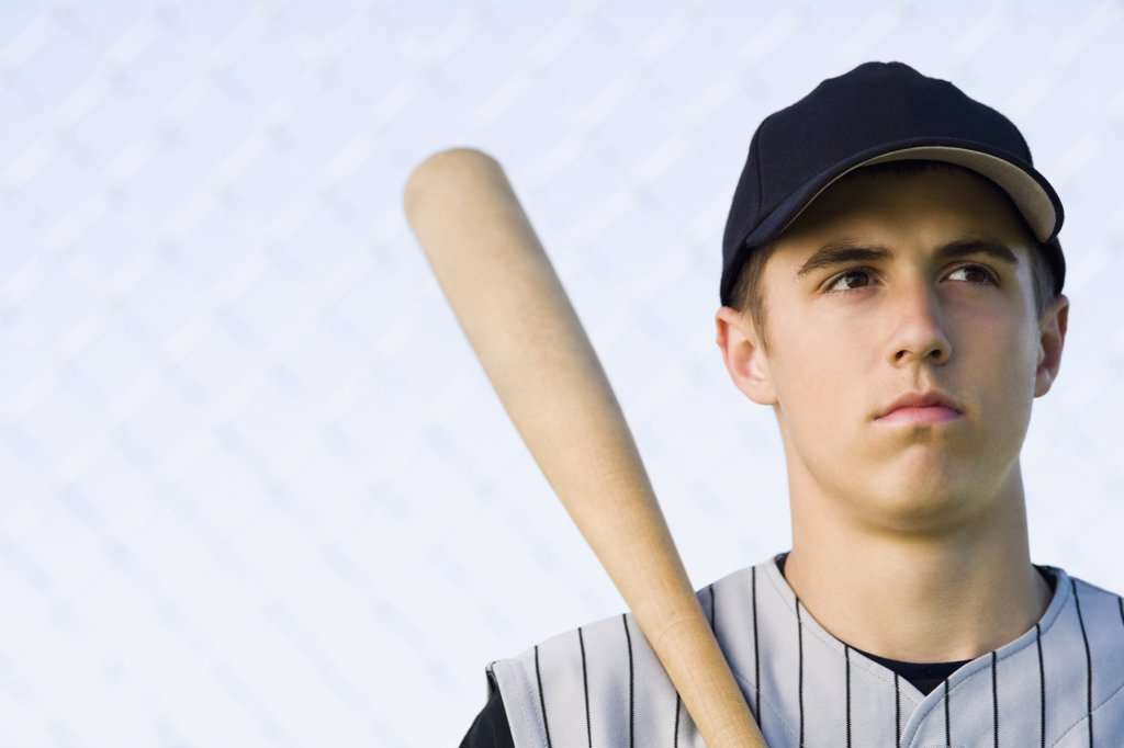 Stock Photo: 1574R-36294 Close-up of a teenage boy holding a baseball bat