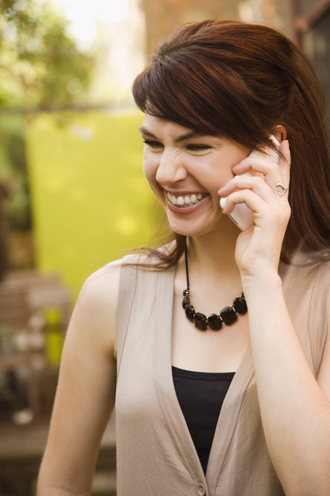 Woman talking on a mobile phone : Stock Photo