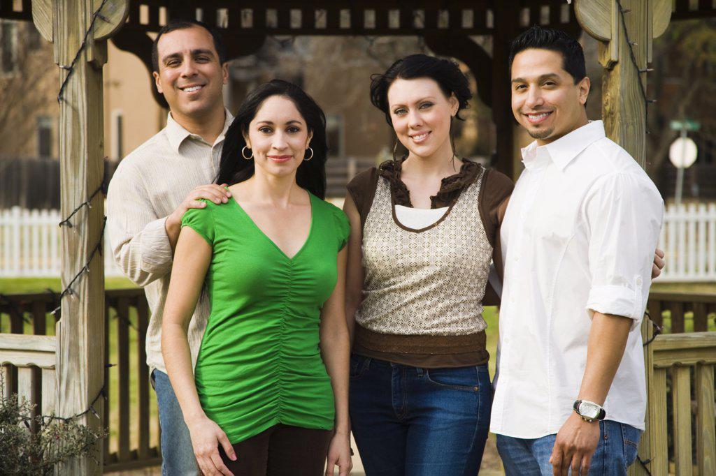 Portrait of four friends smiling : Stock Photo