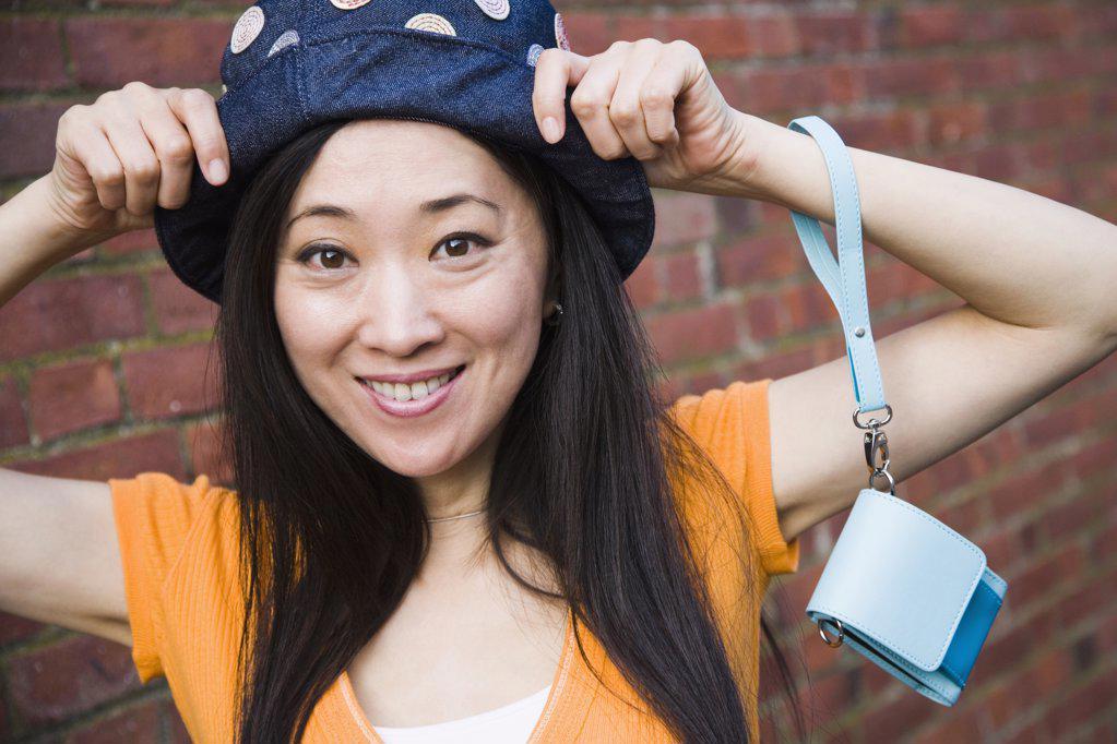 Portrait of a woman wearing a hat, Chatham, Cape Cod, Massachusetts, USA : Stock Photo