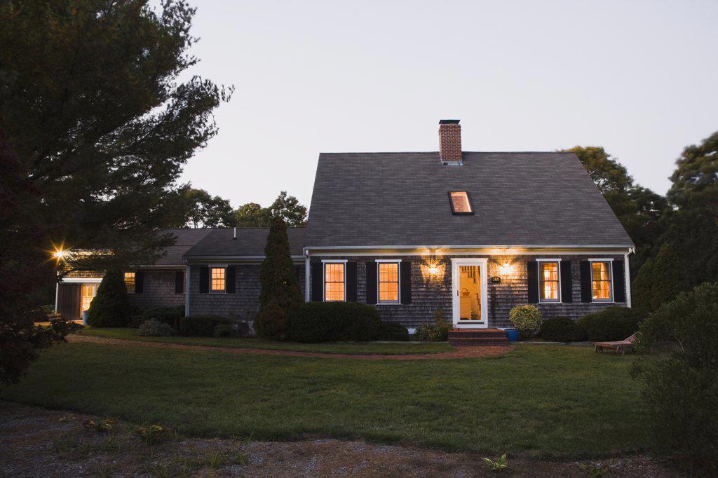 Stock Photo: 1574R-36878 House lit up at dusk, Cape Cod, Massachusetts, USA