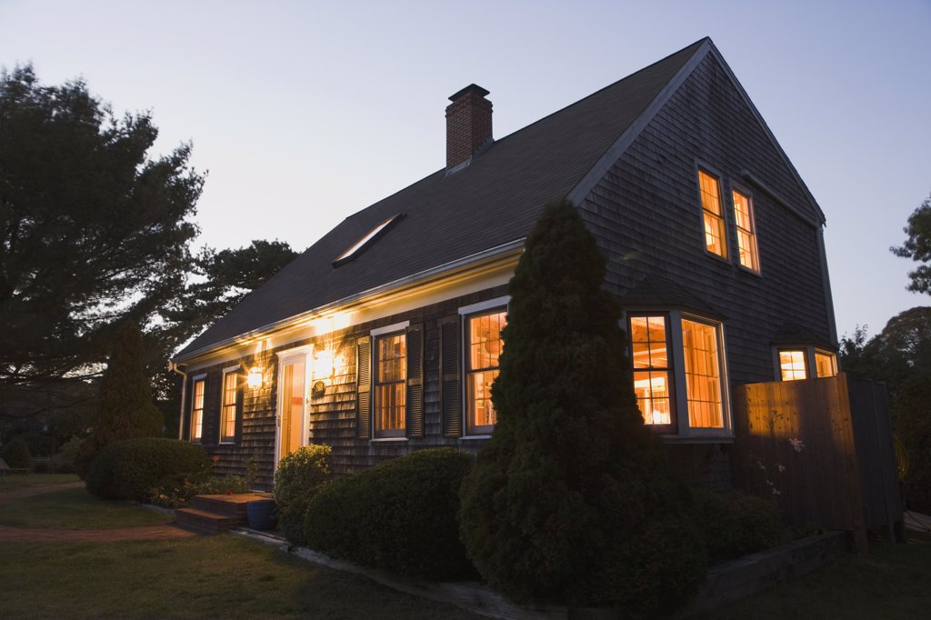 Stock Photo: 1574R-36879 House lit up at dusk, Cape Cod, Massachusetts, USA