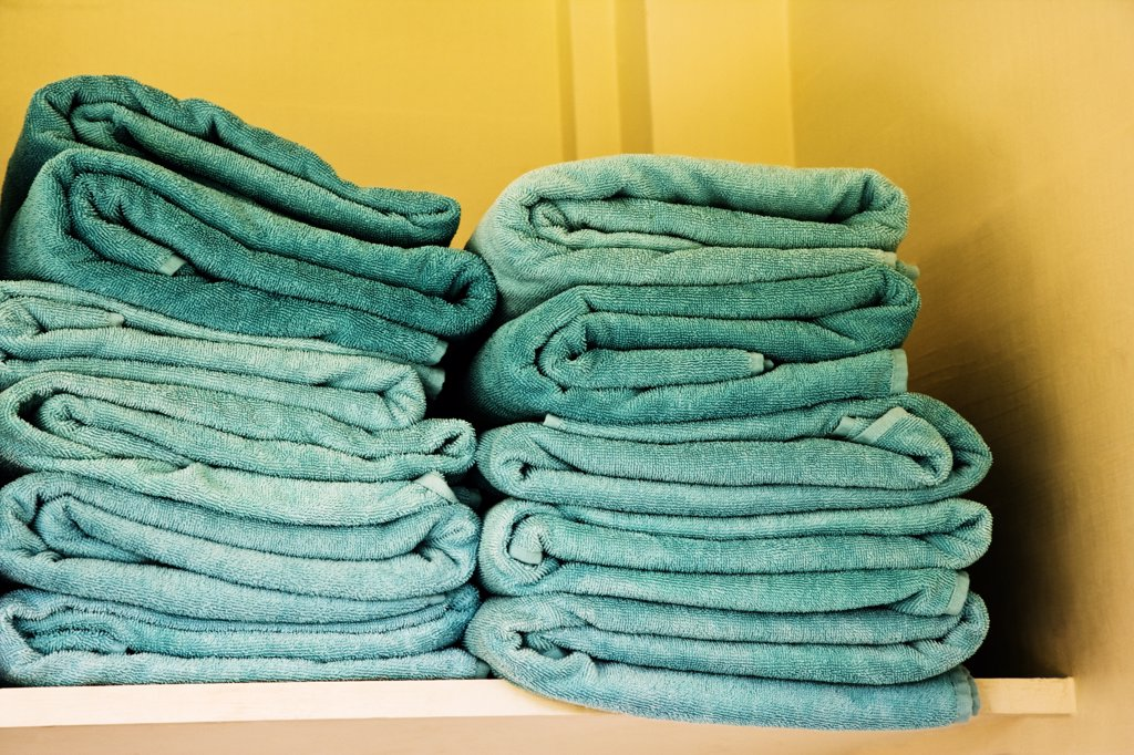 Stack of towels on a rack : Stock Photo