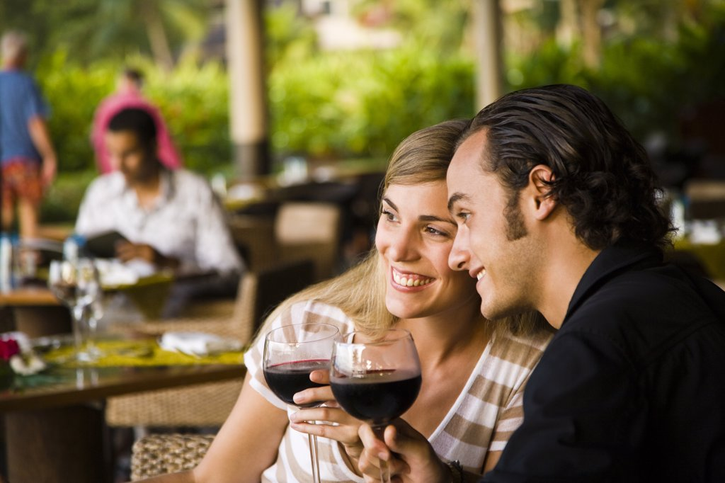 Couple enjoying wine, Papeete, Tahiti, French Polynesia : Stock Photo