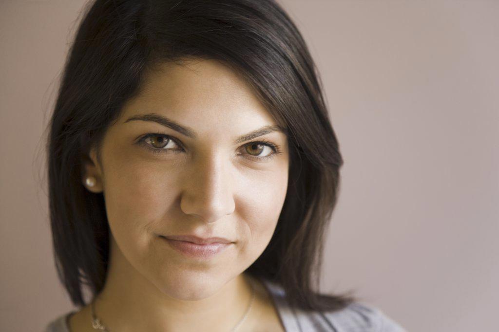 Portrait of a woman smirking : Stock Photo