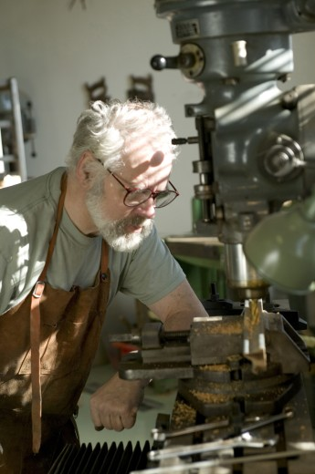 Close-up of a senior man working in a wood workshop : Stock Photo