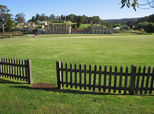 Fence with prison buildings in the background, Penal Colony, Port Arthur, Tasmania, Australia : Stock Photo