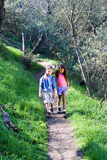 Boy and girl walking on a trail : Stock Photo