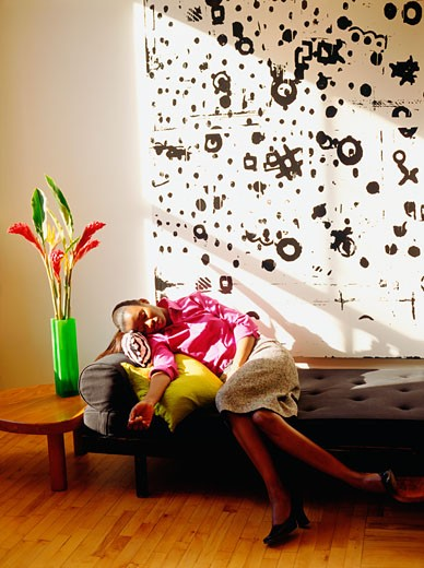 Young woman sleeping on a couch : Stock Photo
