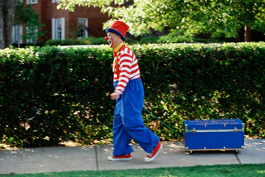 Stock Photo: 1574R-37465 Clown pulling a wagon