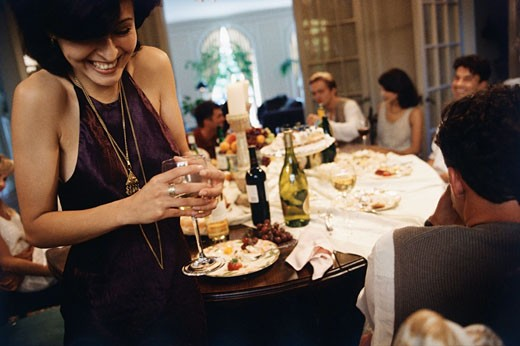 Friends enjoying in a dinner party : Stock Photo