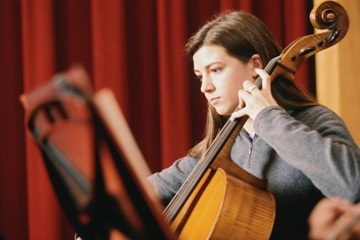 Young woman playing a cello : Stock Photo