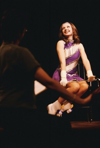 Young woman performing on the stage : Stock Photo