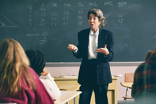 Stock Photo: 1574R-37508 Female professor giving lecture to the university class
