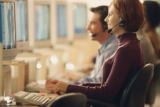 Customer service representatives working in an office : Stock Photo