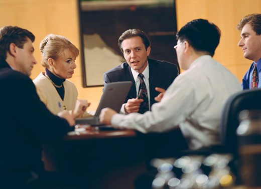Stock Photo: 1574R-37516 Business executives discussing in a meeting