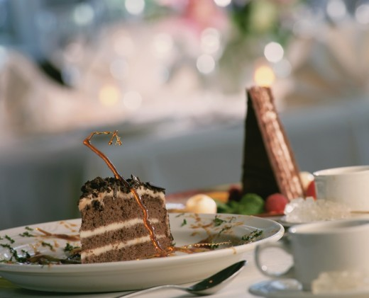 Chocolate cake and coffee cups on a table : Stock Photo
