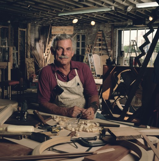 Portrait of male carpenter working in his wood shop : Stock Photo