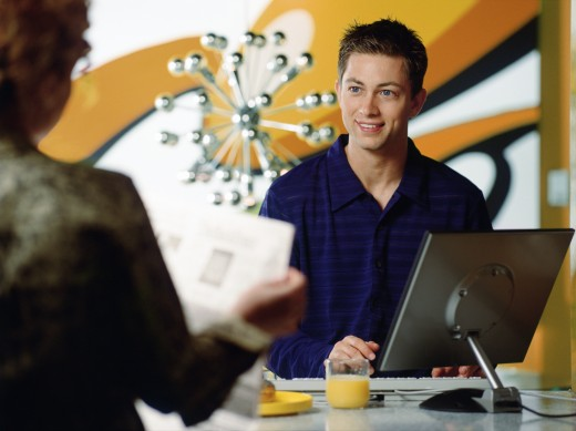 Teenage boy using a desktop PC : Stock Photo