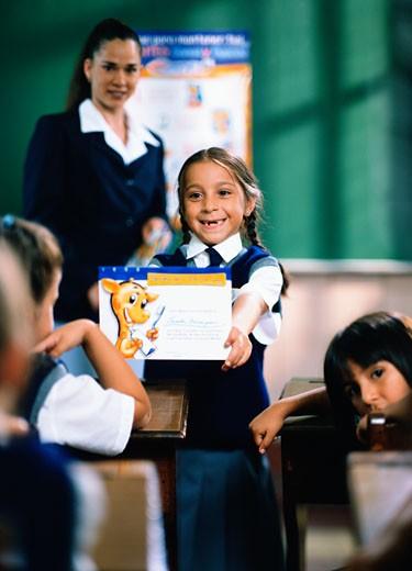 Schoolgirl showing her award : Stock Photo