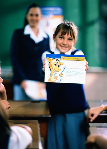 Schoolgirl showing her award : Stock Photo