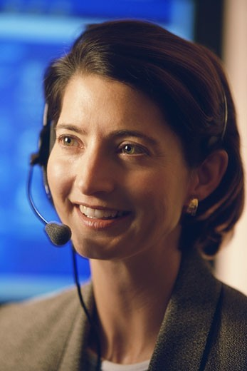 Stock Photo: 1574R-37557 Close-up of a female customer service representative smiling