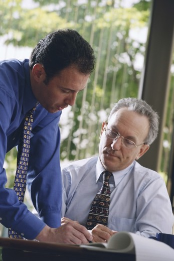 Stock Photo: 1574R-37559 Two businessmen working in an office