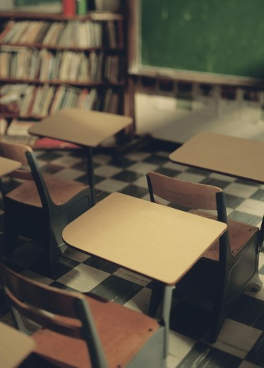 School desks in a classroom : Stock Photo