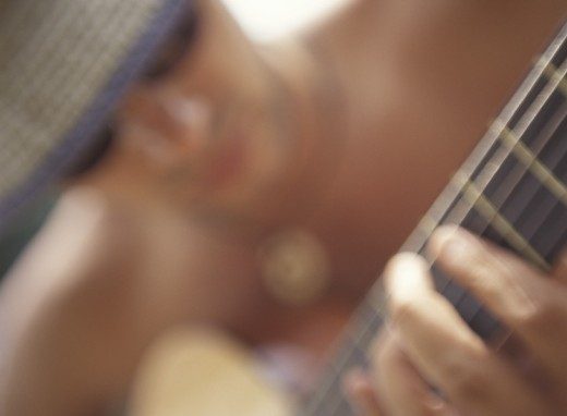 Stock Photo: 1575-02351 Blurred portrait of man playing Guitar