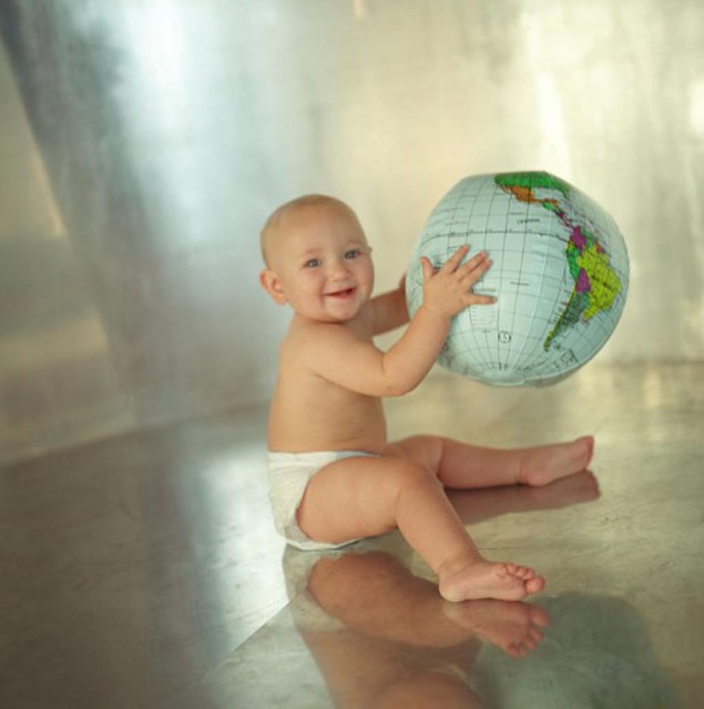 Baby holding globe : Stock Photo