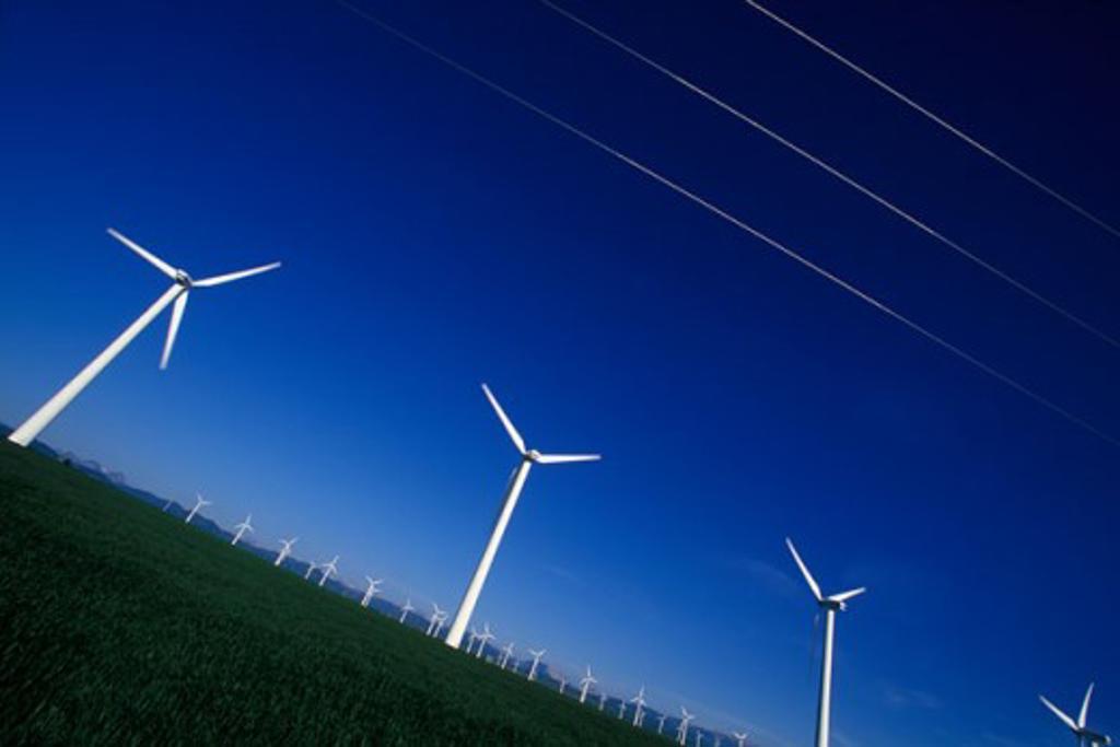 Metal Windmills creating clean electric energy, Pincher Creek, Alberta : Stock Photo