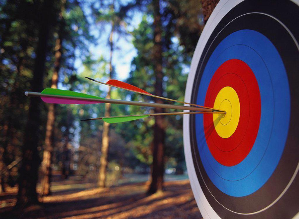 target and arrow splitting arrow. : Stock Photo