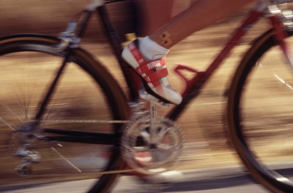 Close up of wheels/frame of a bicycle, blurry : Stock Photo