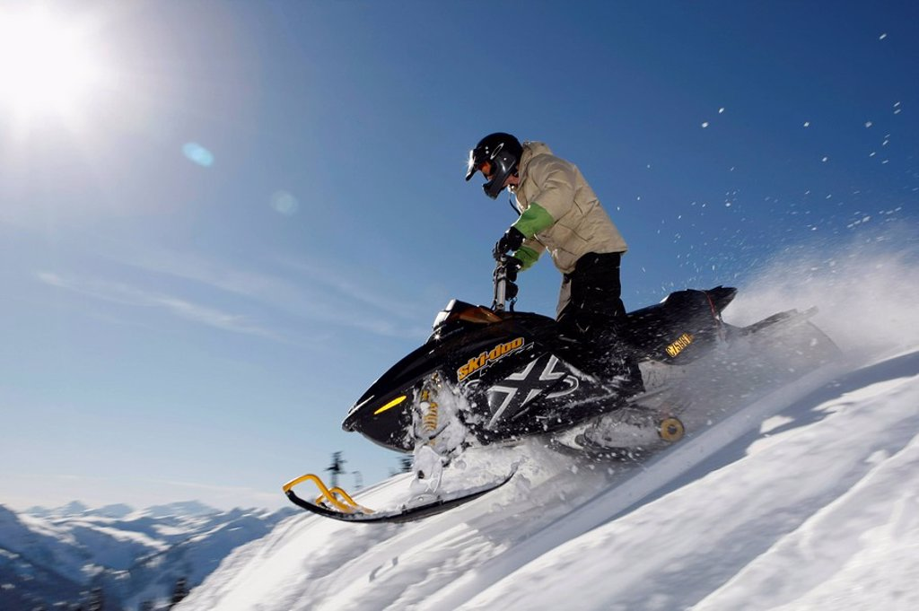 Stock Photo: 1575-9403 Man on snowmobile, Whistler, British Columbia, Canada