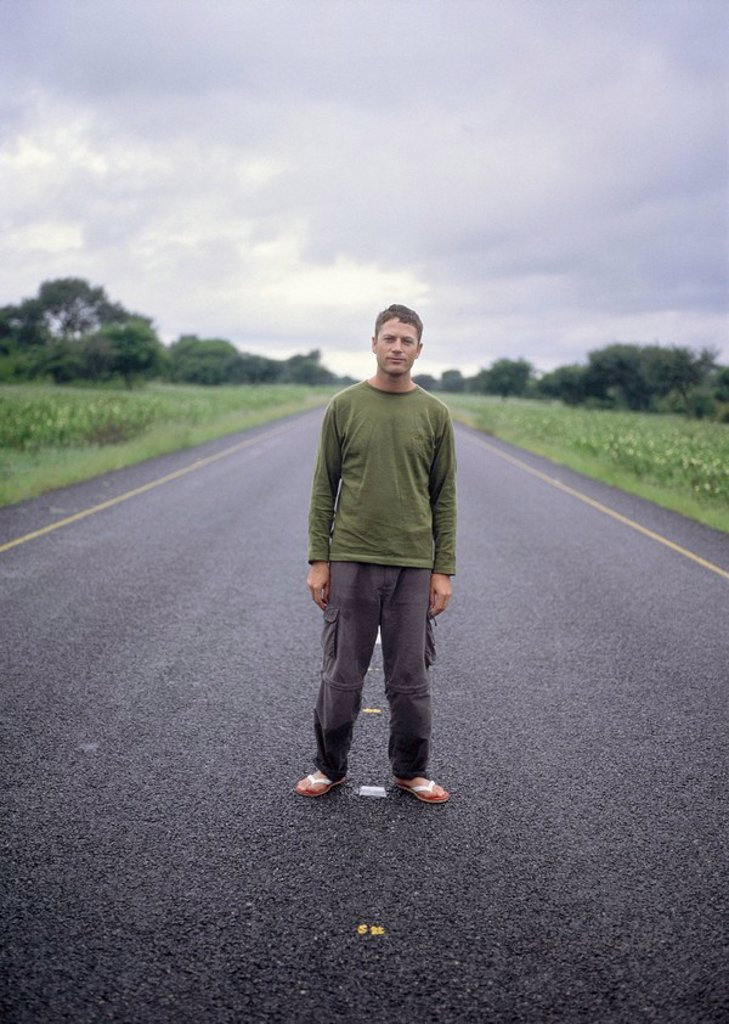 Man on road, Africa : Stock Photo