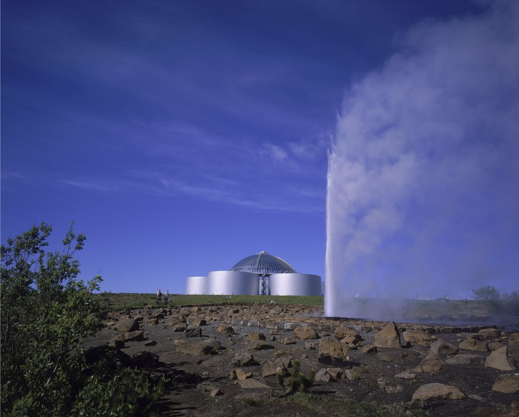 Geyser in front of a restaurant, Perlan Restaurant, Reykjavik, Iceland : Stock Photo