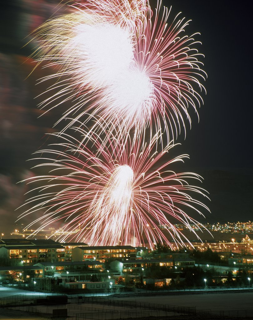 Fireworks over a city at night, Reykjavik, Iceland : Stock Photo