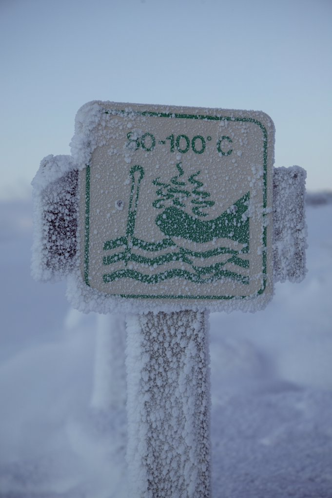 Close-up of a warning sign covered with snow, Iceland : Stock Photo