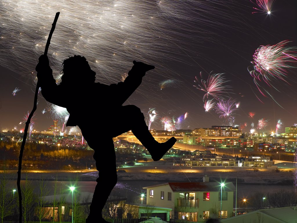 Stock Photo: 1580-543 Iceland, Reykjavik, New Years Eve, Silhouette of Yule Lad (Santa Claus) with firework display in background