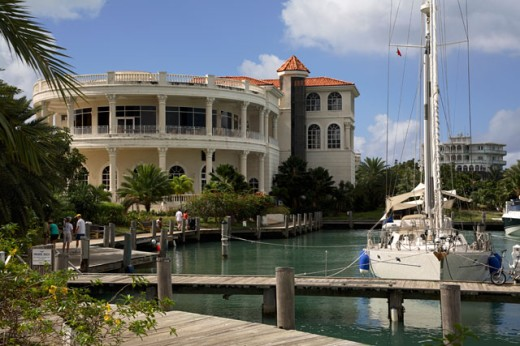 Yacht moored in a harbor in front of a casino, Grand Princess Casino, Jolly Harbor, Antigua : Stock Photo