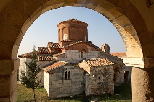 Church viewed through a window, Apollonia, Albania : Stock Photo
