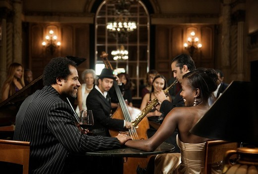 Jazz musicians performing in nightclub : Stock Photo