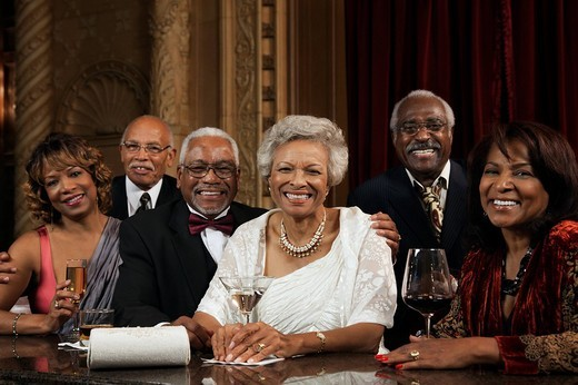 African American people drinking at bar : Stock Photo