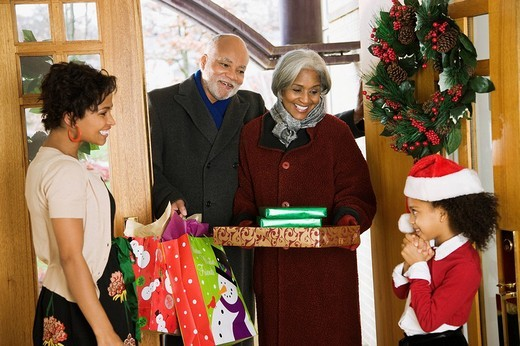 African American grandparents arriving with Christmas gifts : Stock Photo